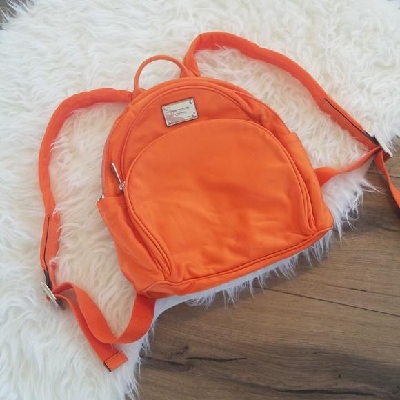 c71973387985 Orange MICHAEL Michael Kors Mini Backpack. M_5b996b1a1b32942d3922b9ea